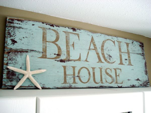 i love everything about this beach house sign: the color, the distressed wood and the sea star of course! Welcome to Our Beach House!
