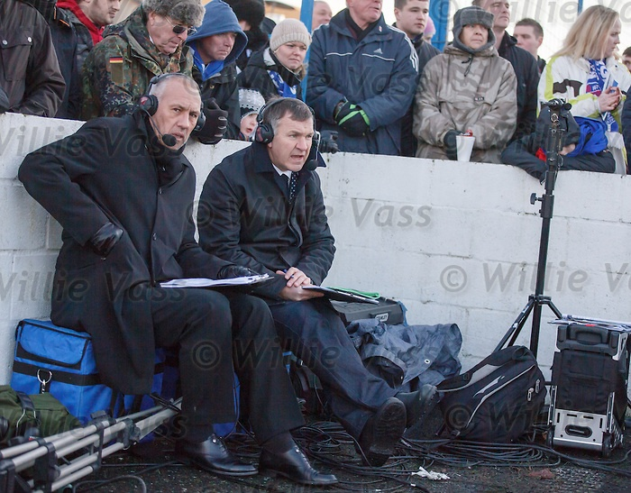 Mark Hateley and Ray Stubbs of ESPN watching the match and taking notes at the corner flag