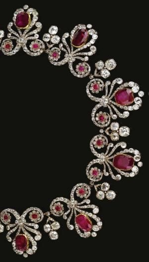 RUBY AND DIAMOND PARURE, 1820S AND LATER The necklace designed as a series of ribbon scrolls set with old-mine, cushion- and rose-cut diamonds, each set to the centre with a cushion-shaped ruby in a cut-down collet and accented with a pair of ruby and diamond florets, interspersed with old-mine diamond trefoil sprigs, length approximately 395mm, accompanied by a tiara frame, a pair of pendent earrings en suite and a ring, size 48, fitted case, by sasmith1983