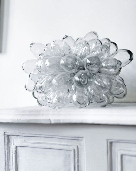ARTILLERIET, CLUSTER LAMP: hand-blown glass mounted on a metal frame, lit from the center.