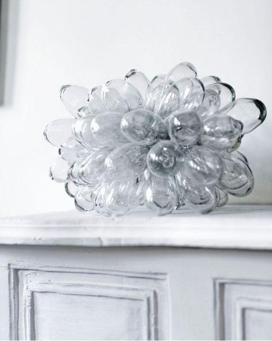 ARTILLERIET, CLUSTER LAMP: hand-blown glass mounted on a metal frame, lit from the center.