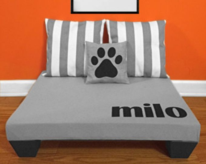 This custom dog bed with personalized modern monogram is the perfect addition to your family space! This raised dog bed will not only give your pet a place to lay in comfort but it will also add a fun element to your room. All of our personalized dog beds are made of top quality home decor upholstery fabrics and each dog bed is padded with 2 of high quality foam for complete comfort. We use the same professional upholstery techniques in our dog beds that we use in all our cornices and…