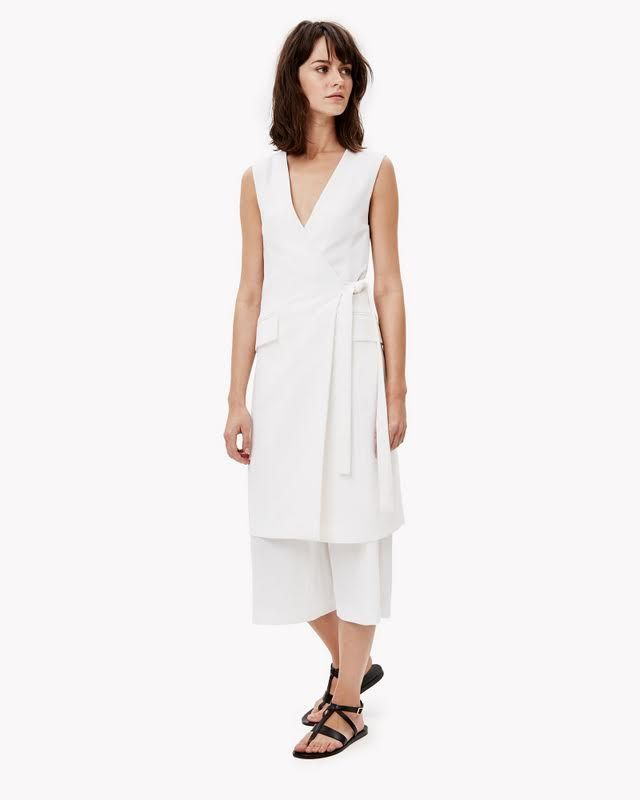Inventive in its wrap-front design and tunic inspiration, this dress offers a modern take on its classic fit-and-flare wrap cousin. Dress yours over cropped or full-length pants for a longer, leaner look. Made in signature tailored crepe for a feminine, elegant touch.