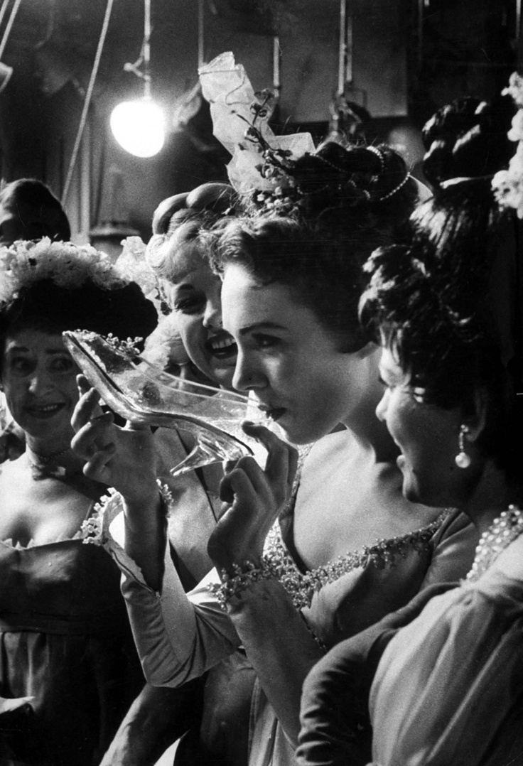 Julie Andrews during the production of Cinderella in 1957, drinking champagne from her slipper.