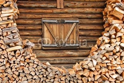 Window of a log house surrounded by wood