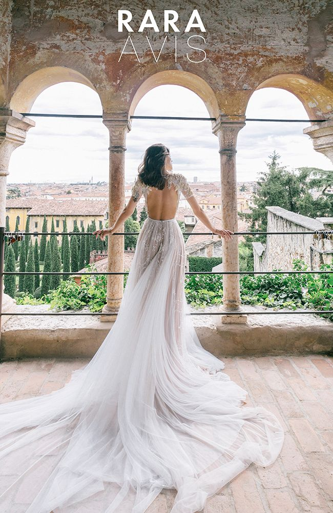 Chantilly lace vintage wedding dress 'Ester' with hand made beading, beautiful open back and gorgeous train. Luxury collection from Rara Avis designer.