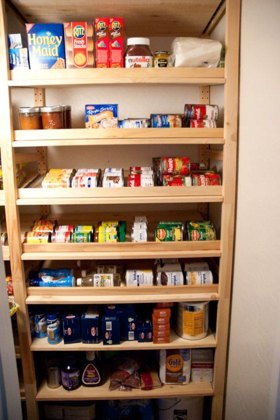 Angled Ikea Ivar shelves for can storage