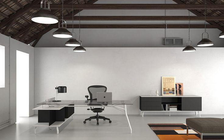 Scrivania Iron Executive by DOIMOffice. Materiali pregiati, design minimalista, l'utilizzo dei piani in vetro fumo: è un sistema caratterizzato da un'estrema versatilità.