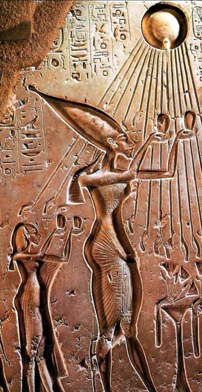 Akhenaten, Nefertiti and the Aten, a circular disk with rays terminating in hands, reaching down toward them. Often the hands hold an ankh. [Myths and Symbols in Ancient Egypt by R.T. Rundle Clark.]