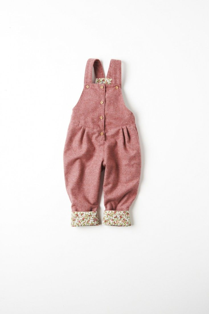 Pink Wool Dungarees With Floral Trim £40.00 We love these awesome dungarees which are a What Mother Made classic! These kids dungarees for girls aged newborn to 4 years old and are wonderfully wintery in gorgeous soft wool and in a vibrant rose with a rosebud floral contrast turn up.