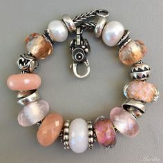 I bought a couple of Rose Quartz beads ($63 USD) a while back and have really been enjoying them. I find they work well with peachy pink bracelets. Here, the Pink Prisms set the tone, but the light…
