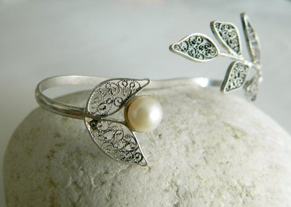 This is a beautiful one of a kind Elegant Filigree palm bracelet. It is a unique handmade piece of jewelry, made with lots of care and love and its ideal for daily casual or night wear. Its a combination of filigree elements made from fine 980 silver wire and fresh water pearl.  The size of the filigree palm cuff is around 19-20 cm long. Its an open bracelet, so its adjustable.   Our jewelry comes in a gift box.  FILIGREE Filigree is one of the oldest and most beautiful art forms ……its a…