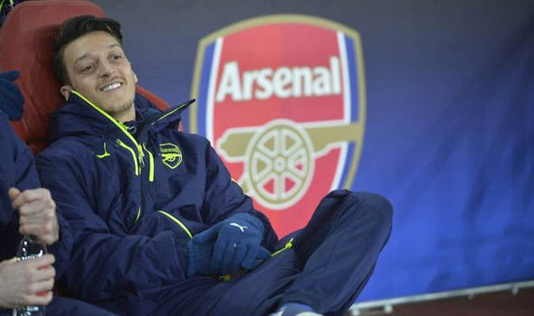 Snapped: Mesut Ozil all smiles on the Arsenal bench during Bayern Munich clash   via Arsenal FC - Latest news gossip and videos http://ift.tt/2nby5gJ  Arsenal FC - Latest news gossip and videos IFTTT