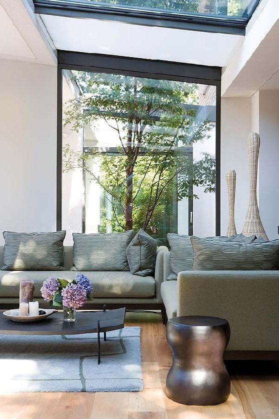 Living area with full height windows onto an internal courtyard garden
