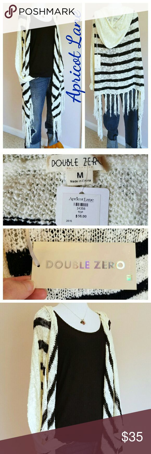 """Apricot Lane Hooded Striped Fringe Cardigan NWT loose knit hooded cardigan with fringe trim by Double Zero for Apricot Lane. Solid cream sleeves, hood, and fringe. Cream and black striped body. Cascading open front falls to approx 36"""" longest length  (44"""" w/fringe). Straight back hits at approx 28"""" shortest length (35"""" w/fringe). 65% cotton, 35% polyester. NWT. New condition. No flaws. Bundle 2+ items and save 20% plus combined shipping! Apricot Lane  Sweaters Cardigans"""