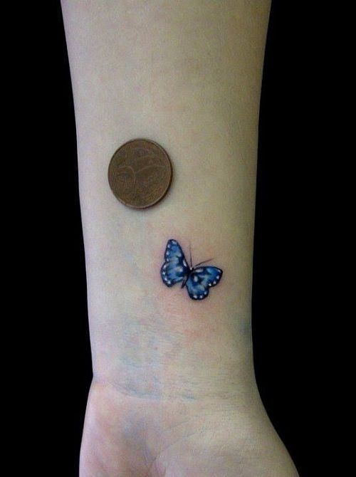 Tiny Blue Butterfly on Wrist Tattoo