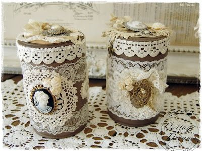 Altered coffee cans, embellished with vintage lace, ribbons, flowers, and jewelry