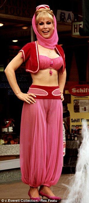 Looking good! The television legend still looked fabulous while baring her impressive midriff in the pink chiffon costume and tiny red velvet bolero and says working out consistently is the key