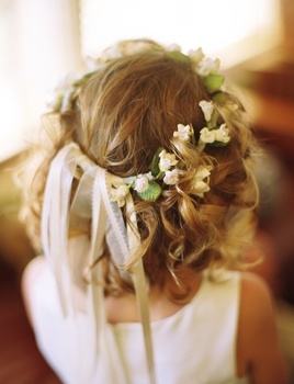 """A halo of flowers adorns the flower girl's curls."""