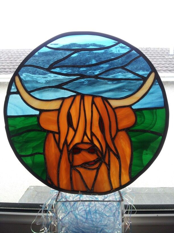 Stained glass Highland cow. Unique design by Glass Gifts Garioch.