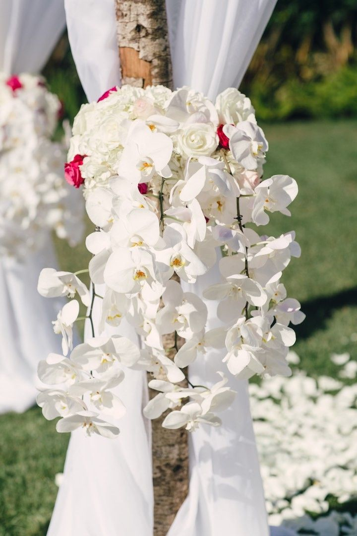 stunning wedding ceremony flowers; Featured Photographer: Mi Belle Photographers