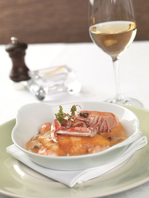 Traditional pike quenelle with langoustine tails