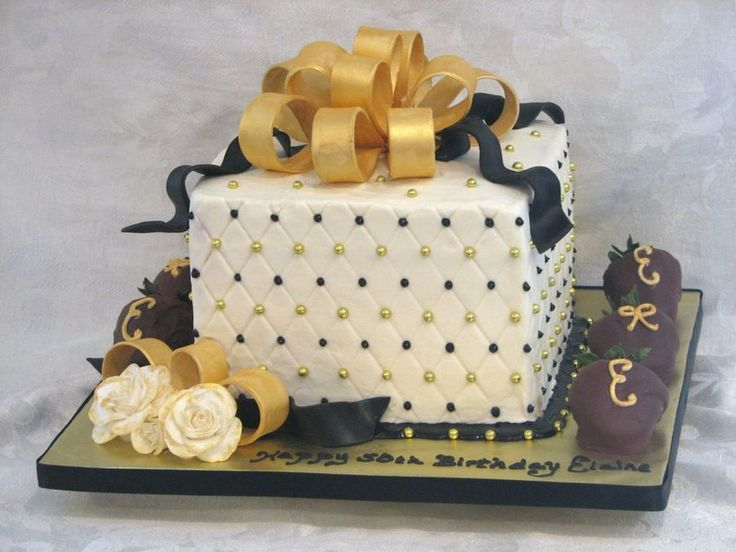 Black & Gold 50Th Birthday Cake iced in buttercream with 50/50 bow painted with luster dust. Handmade gumpaste roses, with the edges...