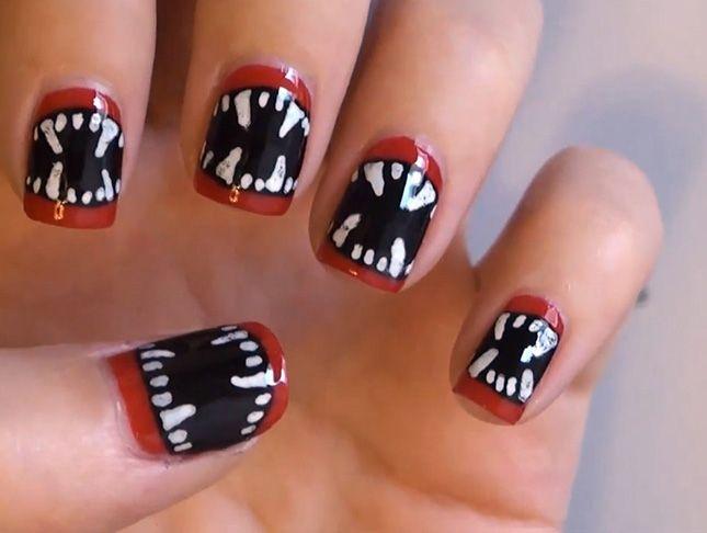 Love this vampire Halloween nail art idea.