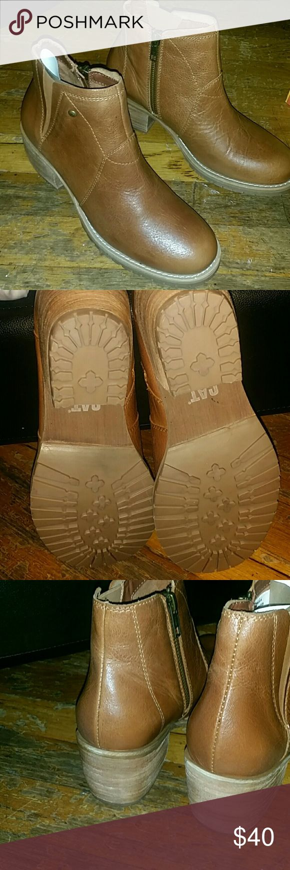 Women's tan CATerpillar leather booties Cute Women's CATerpillar booties. Tan. Leather. Size 7. Sample. Never been worn. In excellent condition. Aside from natural leather variations, no signs of wear. Caterpillar Shoes Ankle Boots & Booties