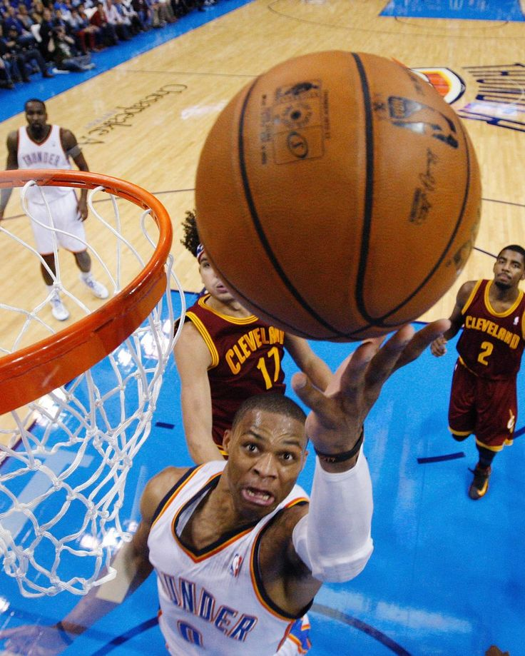 Oklahoma City Thunder guard Russell Westbrook scores against Cleveland Cavaliers during a NBA basketball game in Oklahoma City, United States.