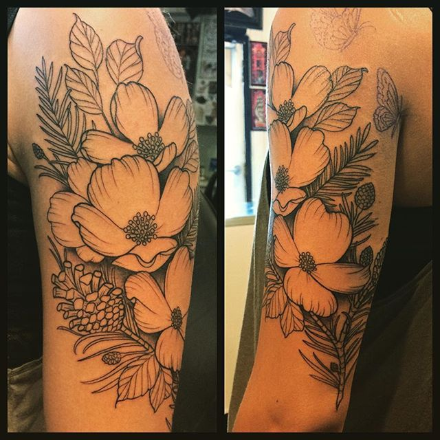 This was Jessica's first tattoo. Decided to go big, with dogwood flowers and pine cones. One more session to go. Thanks for sitting so well!