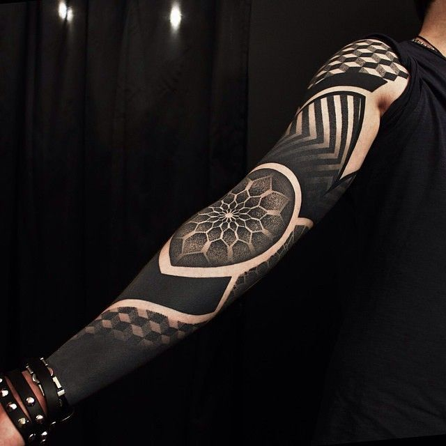 Geometric full sleeve tattoo for men.