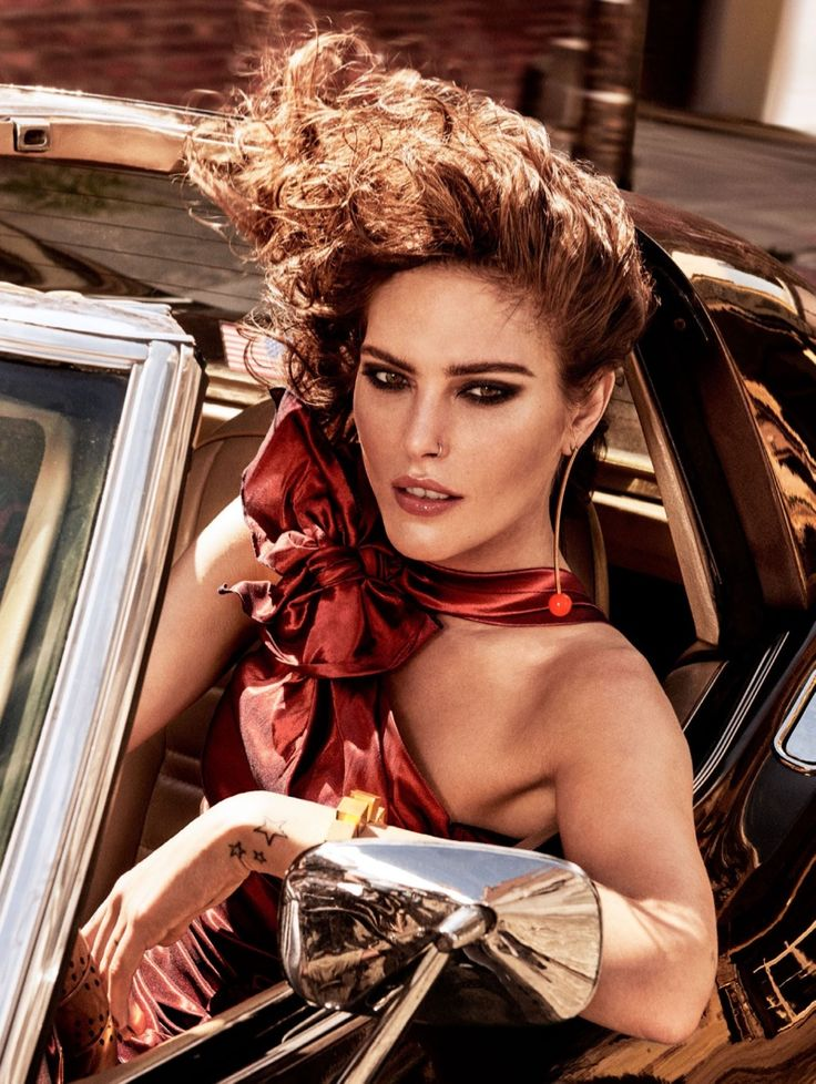 Showing some shoulder, Catherine McNeil poses in red Isabel Marant dress with Stella McCartney earring for Allure Magazine December 2016 issue