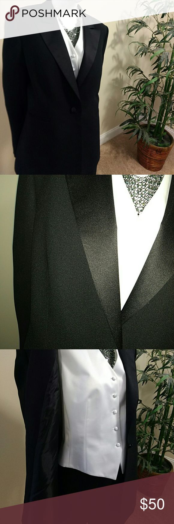 Three-piece classic black women's tuxedo Three pieces are all lined. Classic, never out of style three piece suit. One button jacket satin lapel, satin stripe on outside of legs. Only worn a few times. In excellent condition. The size 14 was tucked in to show on a small mannequin Tahari Pants Boot Cut & Flare