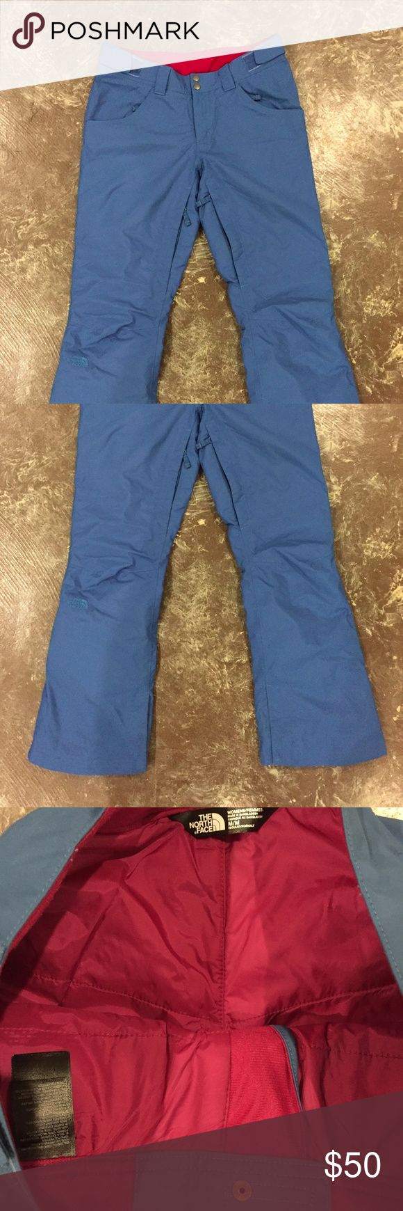 """The North Face Farrows Pant Insulated Ski Pants Women's Farrow Ski / Snowboard Pant in """"Dish Blue"""" with magenta pink lining. Fully waterproof. Size Medium, regular length. Adjustable waist, zips at inner thighs, and gaiters. Front scoop pockets also zip, back patch pockets do not. Excellent condition with  a few minor scuffs at the bottom.  Expected wear and tear. Worn about 5 times. North Face runs a little small--these would be good for someone who wears a 6 or 8 in brands like Gap, J…"""