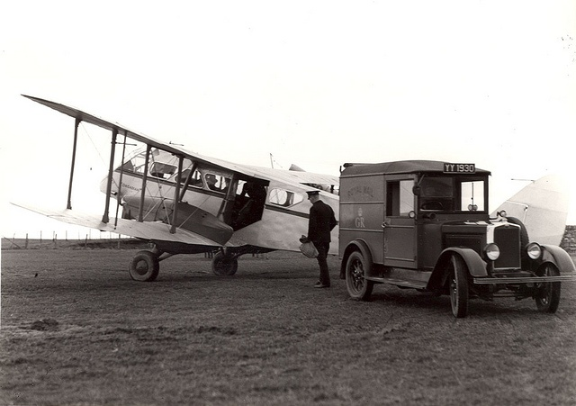 A postman exchanges mail between a light aircraft and Royal Mail van at Wick, Scotland. The aircraft is delivering air mail from the Shetland Island, 1938. (POST 118/0788) | Find more postal photos on Flickr: http://www.flickr.com/people/postalheritage/