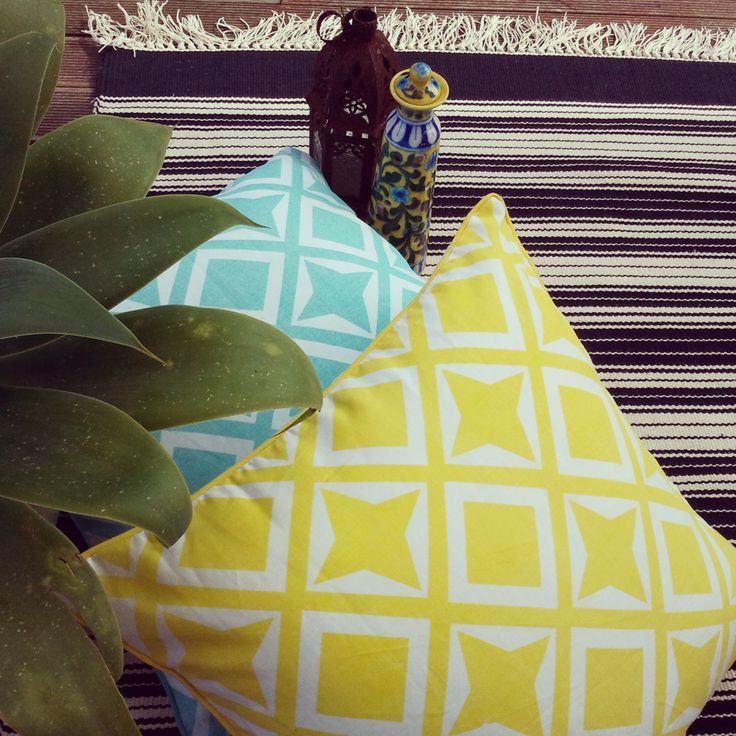 Black & White always looks so contemporary, especially when offset with bright colours & patterns...featured here is my recent handscreenprinted trellis linen cushions against our black white stripe cotton handwoven dhurry....also featured is a yellow floral incense holder....a bit Moroccan the whole styling, don't you think? www.shakiraaz.com.au