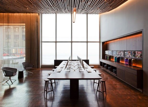 Hotel Row NYC | by Gabellini Sheppard Associates. I like the large table for the computers and the shear curtain along the side that adds transience from the internet area and entrance.