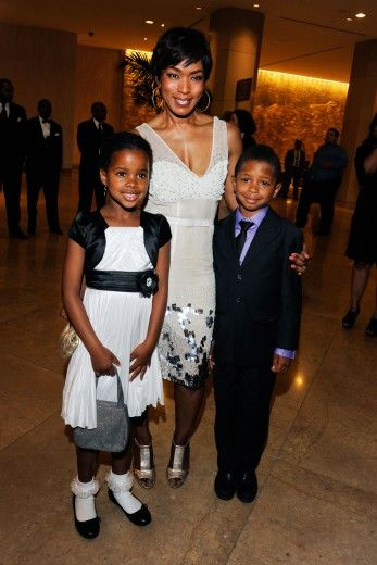 Threes Company Angela Bassett and children attend the CARRY Foundation's 7th Annual 'Shall We Dance' Gala at The Beverly Hilton Hotel in Beverly Hills, California.