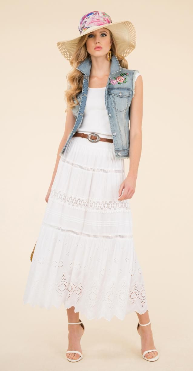 Faded denim vest with floral embroidery, Rita hat and and silk multicolor scarf.