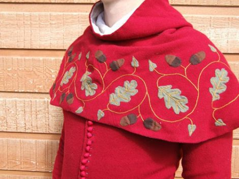 Inspired by: hood embroidered with oak leaf and acorn pattern.