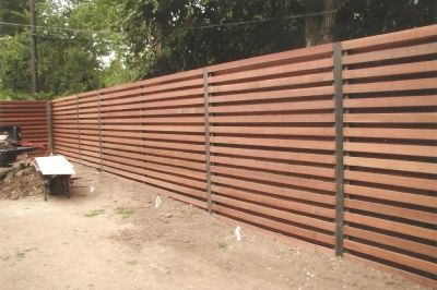 """horizontal shadow box wood fence... """"The Austin Fence Company installs our Horizontal Fences on 4 x4 posts set 24 inches below grade in wet mix concrete. We use Western Red  horizontal cedar picket fence boards in this custom wood fence placed horizontally spaced 2 inches apart and to the desired height. We then repeat the process with horizontal fence pickets on the back side. Protected with a Behr weatherproofer, watersealer, and a natural cedar stain."""""""