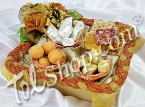 Golden Rakhi Hamper :A beautiful basket lined with golden net and decorated with golden flowers. This visual delight holds mouthwatering mithai and goodies. Rs 1590/- http://www.tajonline.com/rakhi-gifts/product/r2451/golden-hamper-rakhi-kit/?aff=pint2014/