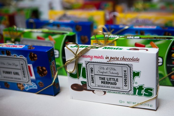 Belinda and Danielle had a hint of a movie theme at their wedding — like reception place cards that were personal boxes of Mike & Ike's and Junior Mints, like you get at a theater.