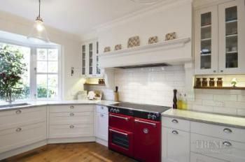 Custom colours for cookers, with three to four ovens and gas or induction cooktops