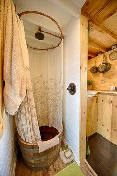 I love the hooped barrel bath / shower in the rustic bathroom from the Tiny Tack House