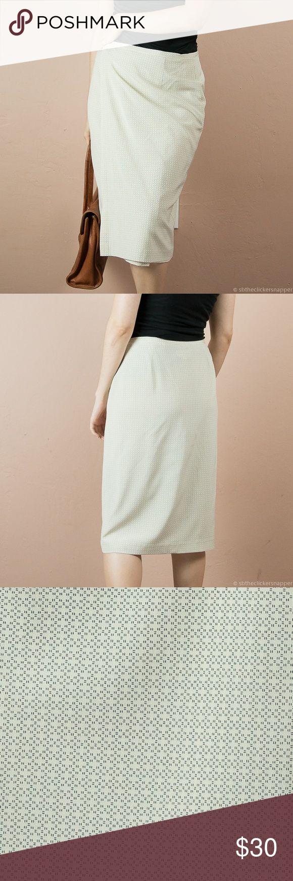 Calvin Klein Wrap Skirt Beige and black print Calvin Klein wrap skirt. Very easy to wear and pair. Shell: 95% silk, 5% Lycra. Lining: 100% polyester. Calvin Klein Skirts Midi