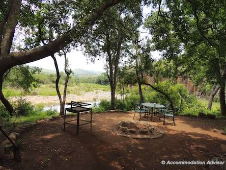 Thalu Bush Camp chalet has an outdoor boma/BBQ area overlooking a river with pools where you can swim (if you're brave!)