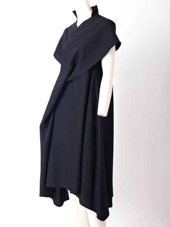 Yohji Yamamoto, wool dress with asymmetric hem and front draped bias panel from shoulder to the hem. Stand collar, short kimono sleeves.view 2