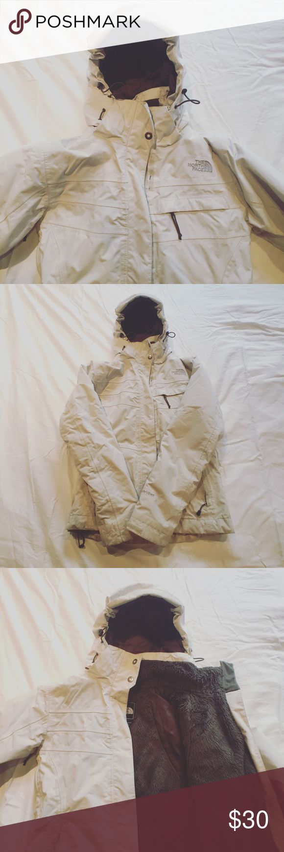 The North Face Winter Jacket Off white with brown accents and detachable hood. Worn, but no damage. Hits at the waist. The North Face Jackets & Coats